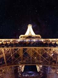 And they say the City of Light was born during the Enlightenment. Perhaps the underbelly of the Eiffel Tower gave a clue.