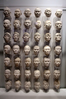 A creepy wall of face moulds.
