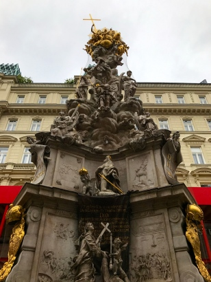 Placed in the middle of one of Vienna's most famous streets the huge gilded, baroque confection of a sculpture at its center is in fact a memorial to the worst plague in Viennese history.
